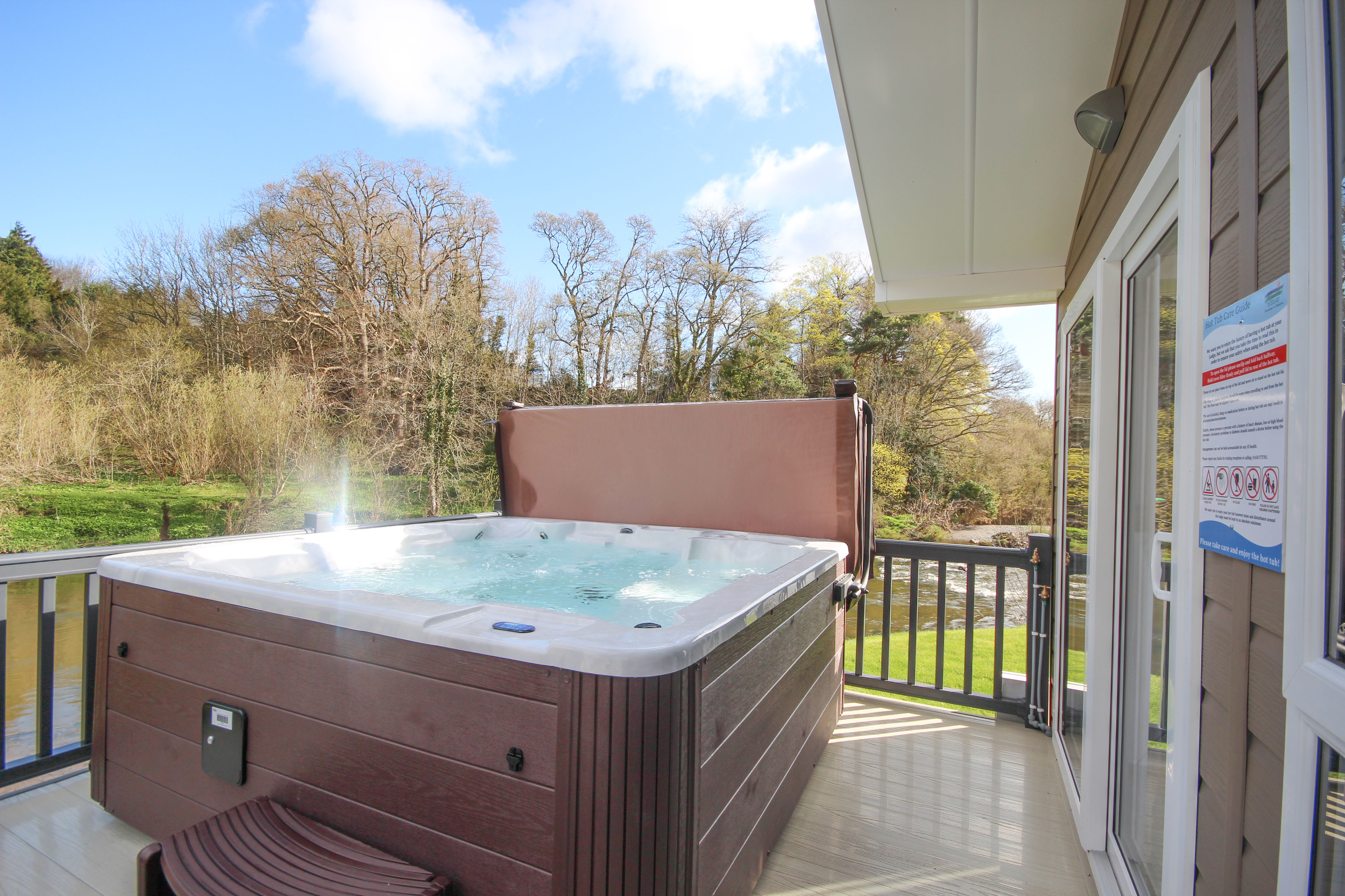 portrait with longlands hot at in for information tub glamping booking prices luxury devon